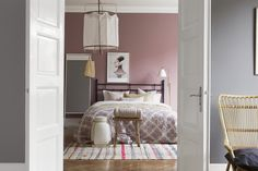 Pink paint. Pink and Gray bedroom. Iron headboard.  John Robshaw quilt.  Boråstapeter - Pigment