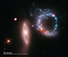 Arp 147 galaxies - This image of the two galaxies that form Arp 147 shows a vast cosmic ring of stars (blue) and black holes (pink) as seen by the Chandra X-ray Observatory and Hubble Space Telescope. Another galaxy is also visible (vertical at left), as well as a bright star and quasar (pink object at upper left).  Credit: NASA/CXC/MIT/S.Rappaport et al, Optical: NASA/STScI