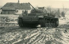 Pz.Kpfw Panzer III in Russia. It has winter tracks installed which are wider than the usual narrower tracks.