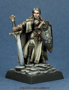 Isabeau Laroche, Female Paladin from Reaper Miniatures, painted by Derek Schubert. Love the muted color scheme and the freehand owl on her shield.