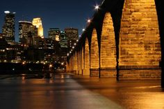 Stone Arch Bridge in Minneapolis, MN. Dating to 1883, this former rail bridge was converted in the early 1990's to serve pedestrians and bikes as they cross the Mississippi River.