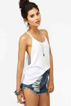 I love the look of these style tanks. Casual and sexy, but someone PLEASE tell me how to wear a bra with this!?