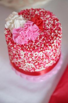 Beautiful heart sprinkle cake at a Valentine's Day Party!  See more party ideas at CatchMyParty.com!  #partyideas #valentine