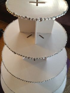 cupcake tier. diy. i purchased this cardboard cupcake tier off Koyal Wholesale & i bling'd it up myself. i purchased one big bag of the faux diamonds/rhinestones. i glued each one on the edge of each tier with a hot glue gun. it looked great at my wedding & didnt break. it held all 90 cupcakes! simple but nice.