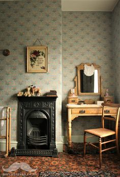 Here is a replica 1880s linoleum printed floor in my Victorian bedroom. Popular patterns replicated wallpaper designs, tiles, wooden floors and carpets. Read my blog post on its history and why it fell out of favour. #linoleum #vintagelinoleum #victorianbedroom #victorianfireplace #antiquewallpaper