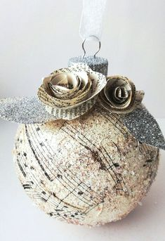 Paris Christmas: Vintage, Music Paper, Ornament with Paper Flowers. - These make beautiful ornaments the tree and home décor. Paper Ornaments, Christmas Ornaments To Make, Noel Christmas, Christmas Paper, Christmas In Paris, Xmas Crafts, Homemade Christmas, Christmas Projects, Christmas Decorations