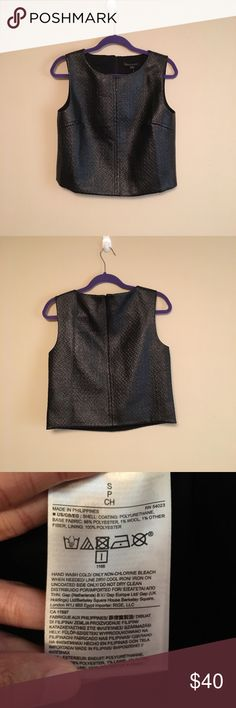 "Banana Republic Edgy Metallic Black Crop Top Banana Republic Edgy Metallic Black Crop Top. Size small. In my opinion it does not fit true to size and would better fit a medium. Length: approximately 19.5"" from shoulder to hem. Bust: approximately 18"" across. Base fabric: 98% polyester, 1% wool, 1% other fiber. Lining: 100% polyester. Price is negotiable and ships next day. Banana Republic Tops Crop Tops"