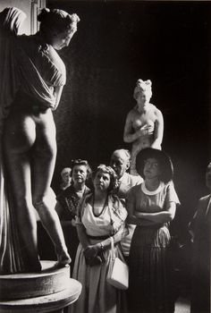 David Seymour - Visitors observing a statue at the National Archaeological Museum, Naples, Italy, 1952
