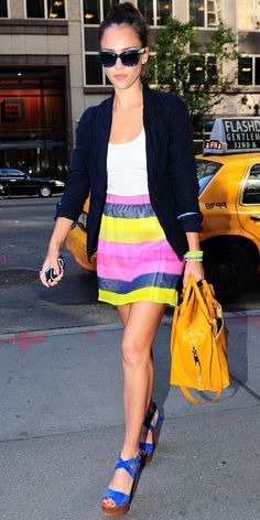 Jessica Alba took Manhattan in a striped miniskirt that she styled with printed Dolce & Gabbana shades, a cuffed blazer, convertible bag and electric blue sandals.