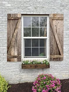 Add rustic charm to your space with these decorative, rustic window shutters. Th… Add rustic charm to your space with these decorative, rustic window shutters. Window Shutters Decor, Outdoor Shutters, Cedar Shutters, Farmhouse Shutters, Rustic Shutters, Diy Shutters, Wooden Shutters Exterior, Outside Window Shutters, Farmhouse Décor