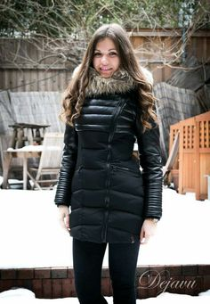 Memory down filled puffer, leather at sleeves and upper body, and  asymmetric front zipper front closure. Quilted insert at waist, fur trim at  hood.