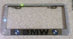 "BMW License Plate Frame made with Swarovski Crystals - BMW Car Jewelry. Handmade Crystal BMW Chrome License Plate Frame made with Genuine Swarovski Crystals High quality chrome license plate frame - Standard Size 12.25"" x 6.3"" We do not use or mix in any other rhinestones of lesser quality like other sellers, who claim their product is genuine These crystals are 100% Swarovski! High Quality Very Strong Adhesive is used to apply each crystal one by one, which will withstand weather…"