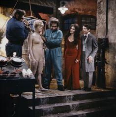 Poor old Emily Bung (Joan Sims) is prepared for vitrification by Oddbod (Tom Clegg), Oddbod Junior (Billy Cornelius), Valeria Watt (Fenella Fielding) and Dr Orlando Watt (Kenneth Williams) - Carry On Screaming!