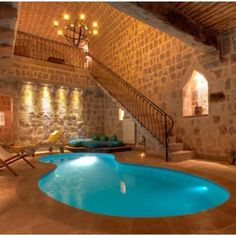 Indoor pool room, with a bigger pool leading to a outside pool of course