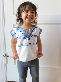 The Chiapas Blouse, Blue, from Jolom Mayateik, a fair trade women's weaving cooperative in Chiapas, Mexico. Hand-embroidered.