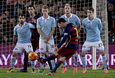 Barcelona's Argentinian forward Lionel Messi shoots a free kick to score a goal during the Spanish league football match FC Barcelona vs RC Celta de Vigo at the Camp Nou stadium in Barcelona on February 14, 2016