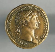 A Profile of Roman Empire and Soldier Trajan: Sestertius of Trajan, minted in Rome, bearing the image of the emperor, recto. Roman coins, 1st century AD.