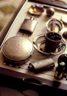 Vintage flask & pocket watch -- for more accessories photography, visit my board http://pinterest.com/davidos193/essentials-mens-accessories/