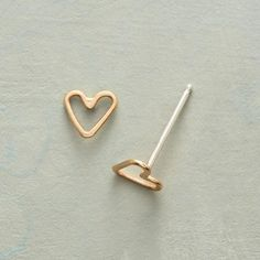 TINY HEARTS, BIG LOVE GOLD EARRINGS - Handmade from recycled precious metal, tiny open hearts of 14kt gold deliver a big message of love. Sterling posts.