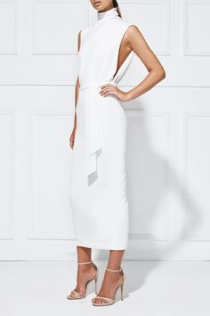 BALBINA DRESS |  Designed in Australia, this dress features a sophisticated high neckline and a hint of skin through a split at the back and exaggerated arm wholes. Crafted from a soft crepe fabric with a subtle surface texture, it features a mini length hemline and synched in waist with separate tie belt.
