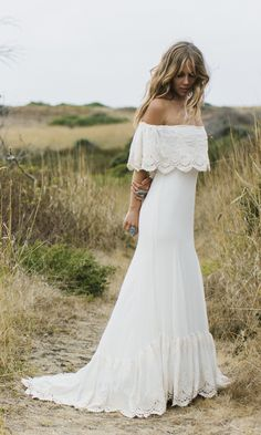 "Bohemian bridal gown, ""Lu"" is our most beloved off the shoulder wedding gown. This ivory dress is lined with a matte stretch satin liner layered among"