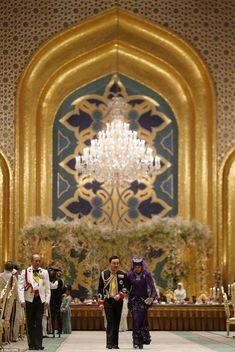 Brunei's newly wed royal couple, Prince Abdul Malik and Dayangku Raabi'atul 'Adawiyyah Pengiran Haji Bolkiah, leave the royal wedding banquet at the Nurul Iman Palace in Bandar Seri Begawan April 12, 2015. Malik is the son of Brunei's Sultan Hassanal Bolkiah, one of the world's richest men.