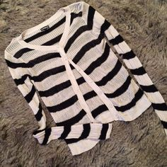 """Express black and cream loose knit cardigan This black and cream striped sweater has a loose knit stitching pattern. Buttons down the front. L:21"""", B:18"""", S:29"""". Seems to run small. Express Sweaters Cardigans"""