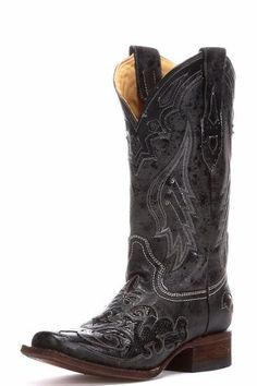 e0a129acb55 This western boot from Corral features impressive scroll cutouts and exotic  python inlays. Its cushioned insole allows for walking comfort while the  fancy ...