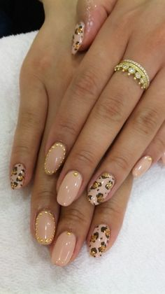Nude leopard print gold glitter and studded nails. I kind of like this.  It's different but not too gaudy.