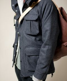 \\ charcoal grey flannel jacket, blue jeans, marl grey cotton cardigan, blue & white stripe pullover, natural leather backpack
