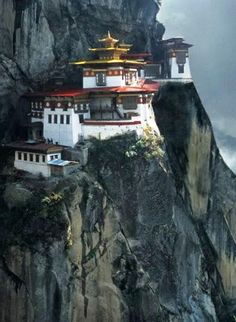 Tiger's Nest Monastery in Bhutan. Paro Taktsang is the popular name of Taktsang Palphug (Tiger's Nest) Monastery, a prominent Himalayan Buddhist sacred site and temple complex, located in the cliffside of the upper Paro valley, in Bhutan. Places Around The World, Oh The Places You'll Go, Places To Travel, Places To Visit, Around The Worlds, Travel Destinations, Bhutan, Place Of Worship, Amazing Architecture