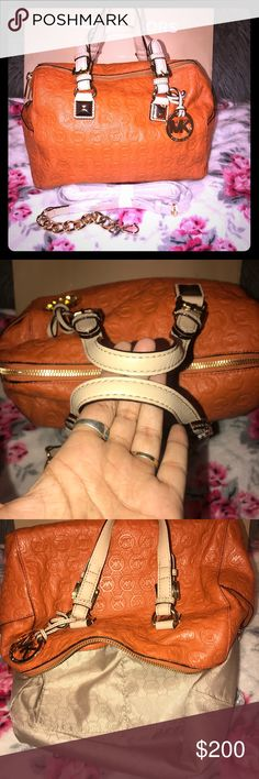 NWOT medium Micheal Kors Grayson Omg this bag is just fabulous for fall. NWOT medium orange 🍊 mk Grayson. Has never been carried but somehow got a small pen mark on the bottom. Everything else is perfect, comes with cross body strap still wrapped up. Trade value 400$ Michael Kors Bags Shoulder Bags