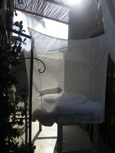 Patricia Larsen garden bed Remodelista - pretty mosquito net pattern