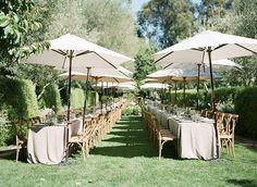 Gorgeous summer wedding reception set up with creme outdoor furniture! A Wanaka Wedding (www.awanakawedding.co.nz).
