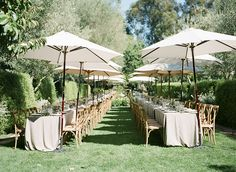 Gorgeous summer wedding reception set up with creme outdoor furniture! A Wanaka Wedding (www.awanakawedding.co.nz).