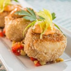 Chef Adam Romans Dungeness Crab Cakes with Corn Relish and Spicy Ginger Aioli Chef Adam Roman of the Four Seasons Resort Lanai join us on Cooking Hawaiian Style to make his own take on a dungeness crab cake served over a bed of fresh corn relish and a spicy ginger aioli. Be sure to catch Adam's episode on OC16.