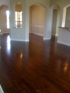 Dark wood floors ...but all I can think of is how much fun it would be to slide in stocking feet across this! :)