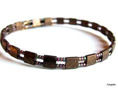 Bracelet en perles Tila or mat bronze sur double fil mémoire tout en perles…