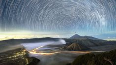 Sparkling starscapes caught on camera - BBC News - Hundreds of stars appear to spin in the sky above Mount Bromo - an active volcano in East Java, Indonesia.
