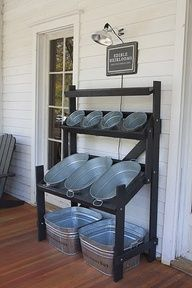 Drink and snack storage for back yard parties, and / or a storage spot for towels while youre swimming, sunscreen, and pool toys. I want this for my house!