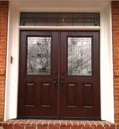 Provia Fiberglass front entry doors with half lights, custom glass, and a transom.  Installed by Nova Exteriors.