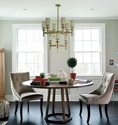 textured dining room: I love this combo of brass, velvet, and wood.