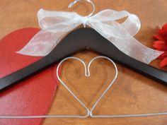 Bride Dress Hanger Wooden Bride Hangers Bridal Shower Gifts  $19.99 Mid Summer Sale  20% Enter code JUL2017  Click on photo to BUY NOW!  This heart wedding hanger is simple yet sweet. #originalbridalhanger makes a variety of hangers for your wedding dress needs. They are the perfect shower gift too.  Click here: originalbridalhanger.etsy.com to see more!