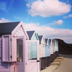 A walk beside candy coloured beach huts under a blue sky #LifesSmallPleasures