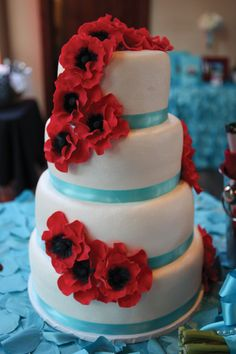 Cute red and turquoise Sugar-Flower Wedding Cake by Rosebeary's Designs.  Photo by Tammy Odell Photography.