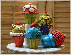 Create-a-Cupcake Kit, includes oven bake clay, cake base, and directions. Need acrylic paint.