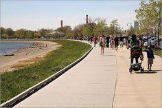 Wide sidewalks stretch along the South Boston shore.