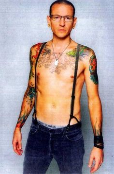 Chester Bennington. Just so sexy!<<< in my opinion, him and suspenders don't work, but he is still amazing.