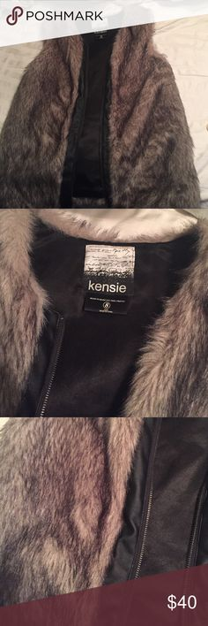 Faux Fur Vest Pleather lined zipper, satin-like inside lining. Grey and black colored fur. Size is small but would fit anyone normally wearing a medium or large. Kensie Jackets & Coats Vests
