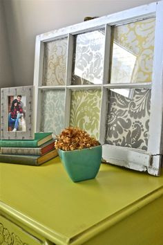 large scale scrap paper or wallpaper samples in a vintage window